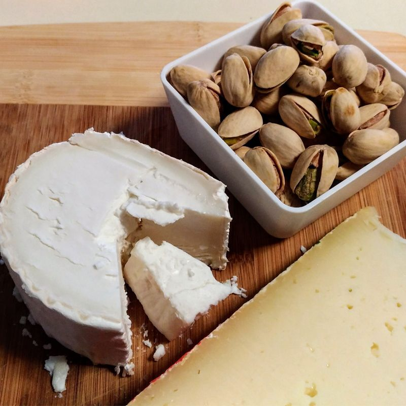 French and italian cheese served with pistachio