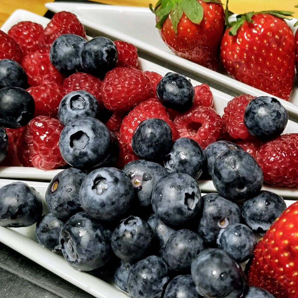 Basket of blueberries, raspberries and strawberries